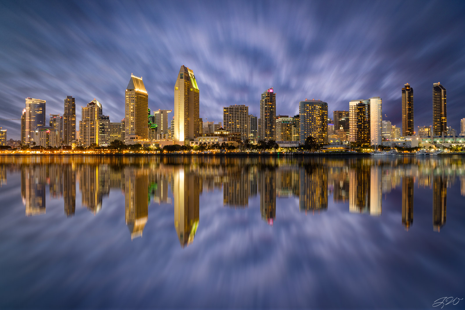Fine Art Limited Edition of 100. The San Diego Skyline at night with an almost perfectly mirrored reflection on San Diego Bay...